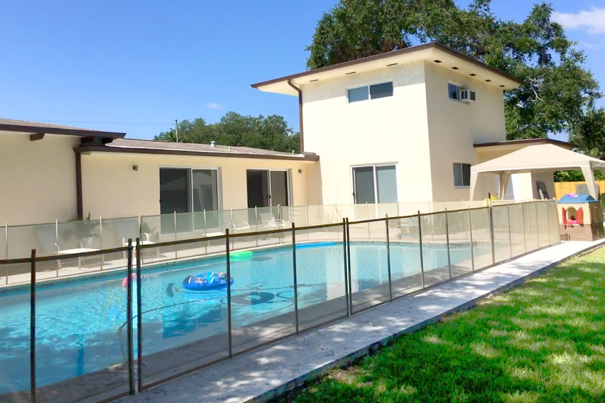 tan pool fence for this lush biscayne park homes large pool - Pool Fence Installation